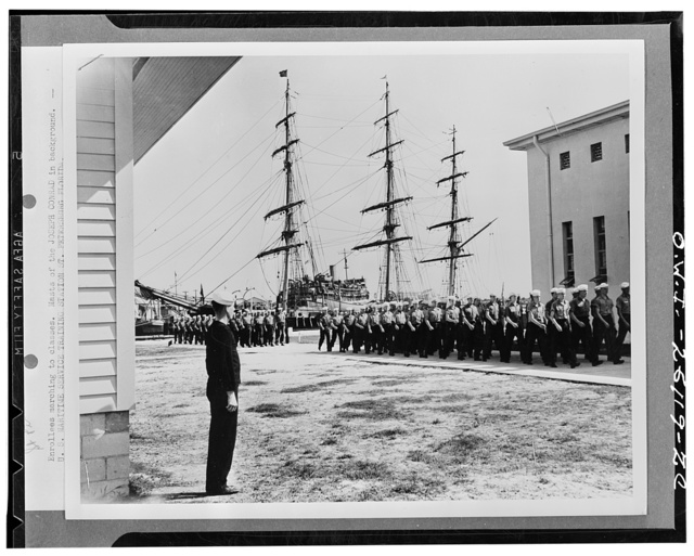 "Saint Petersburg, Florida. Enrellees marching to class at the masts of the training ship.  ""Joseph Conrad"" in the background"