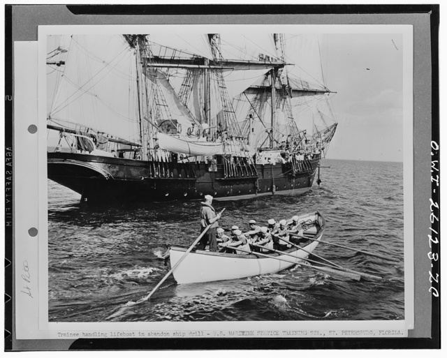 Saint Petersburg, Florida. Trainee at the United States Maritime Service training station handling a life boat in an abandon ship drill