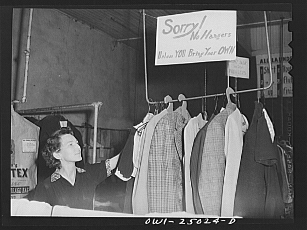 San Augustine, Texas. Girl in a laundry and dry cleaning establishment