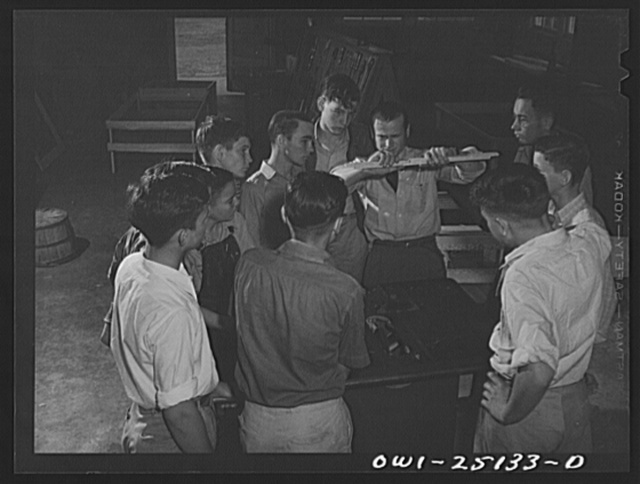 San Augustine, Texas. High school class learning how to operate dado attachment on a saw