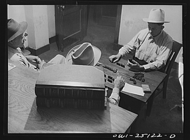 San Augustine, Texas. H.L. Armstrong, Justice of the Peace, in a dominoe game with Jeff Davis, night marshall