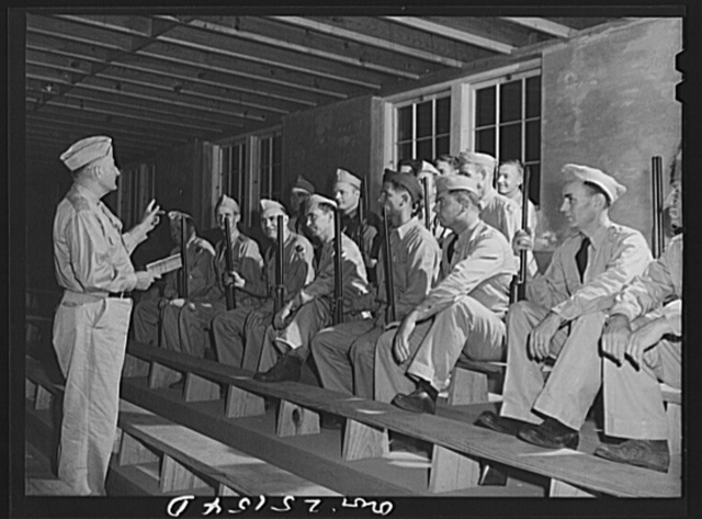 San Augustine, Texas. Lieutenant Gary, local commander of the Texas Defense Guard, lecturing on military courtesy. Lieutenant Gary is the county surveyor