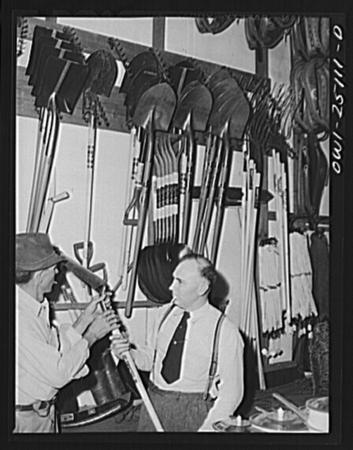 San Augustine, Texas. Man purchasing a shovel at the hardware store