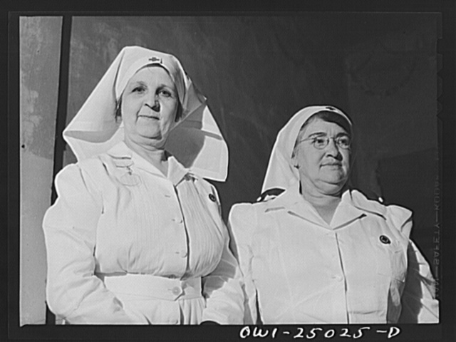 San Augustine, Texas. Mrs. Thomas, wife of the wholesale grocer, and Mrs. Rushing, wife of the mayor, in charge of making surgical dressings for the Red Cross