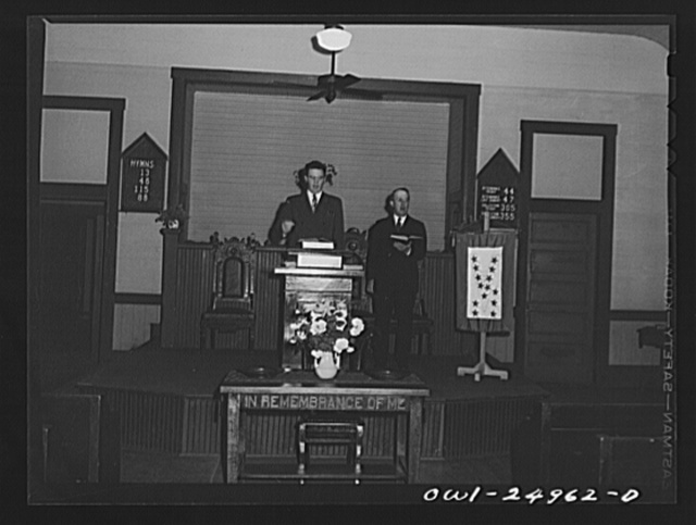 San Augustine, Texas. Reverend Marsh Calloway and the song leader conducting evening service in the Presbyterian church