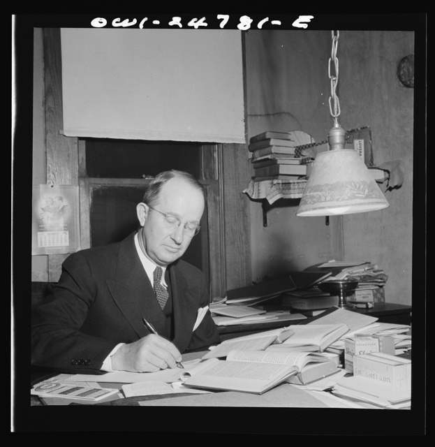 San Augustine, Texas. Reverend Marsh Calloway, Presbyterian minister, preparing his Easter sermon in his study