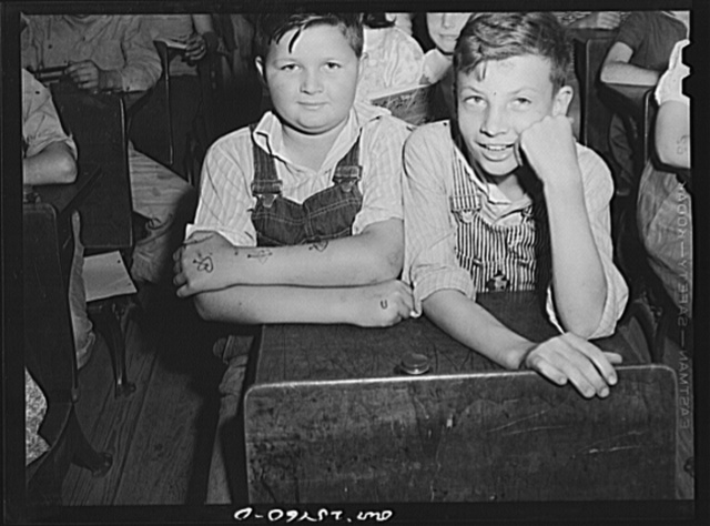 San Augustine, Texas. Schoolboys with ink made tattoo marks on their arms