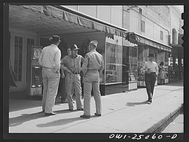 San Augustine, Texas. Soldier home on furlough talking with friends on the main street