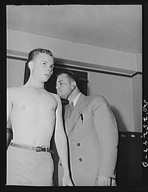 San Augustine, Texas. The eighteen year old grocer's boy receiving a physical examination from Dr. Jones prior to induction into the Army