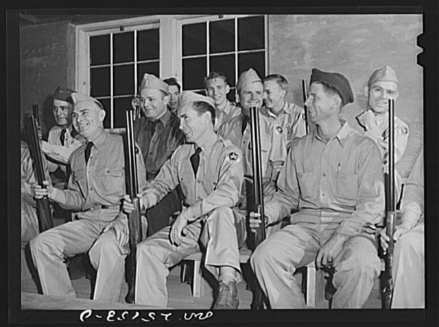 San Augustine, Texas. The members of the Texas Defense Guard assembled in the high school auditorium