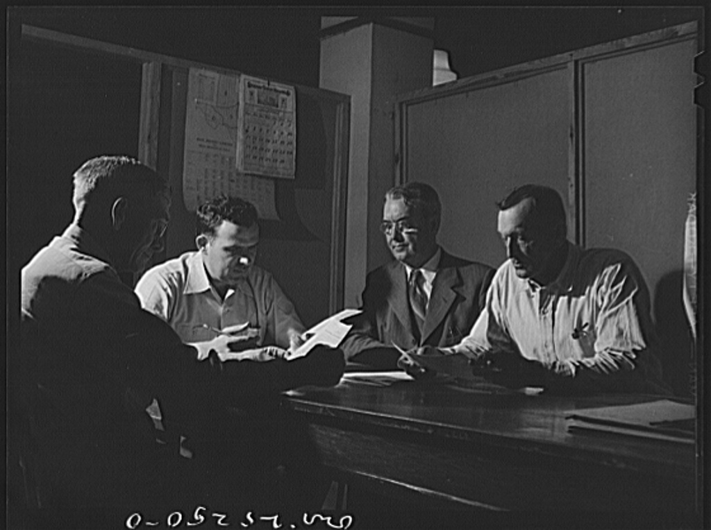 San Augustine, Texas. The rationing board in session. Left to right: Mr. Long, retired rural mail carrier; Mr. Curl, banker; Mr. Wood, clothing store owner; Mr. Brown, AAA (Agricultural Adjustment Administration) supervisor