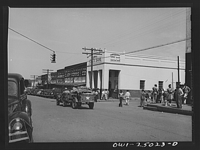 San Augustine, Texas. Troop movement going through the main street on a Saturday morning
