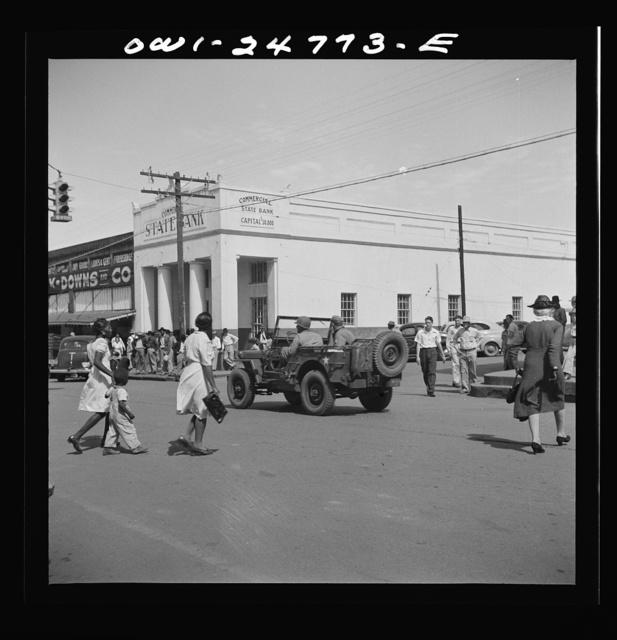 San Augustine, Texas. Troop movement through the main street