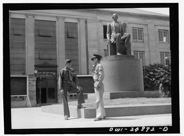 San Augustine, Texas. Two soldiers home on furlough talking in front of the courthouse