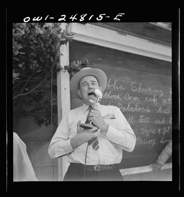 San Augustine, Texas. W.C. Gary, county surveyor and commander of the local home guard, making a speech over the public address system in front of the courthouse