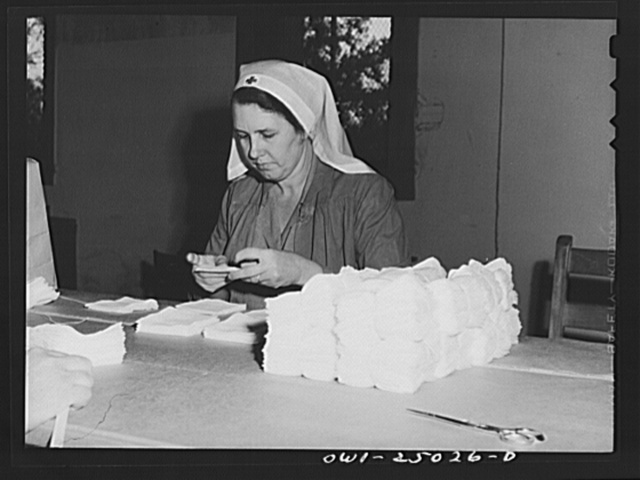 San Augustine, Texas. Woman making surgical dressings for the Red Cross
