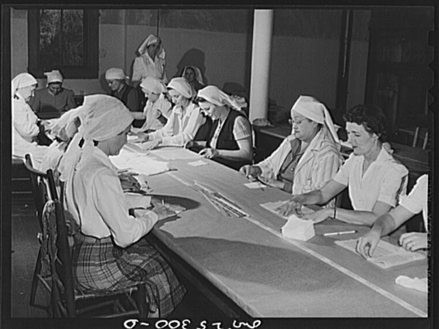 San Augustine, Texas. Women making surgical dressings for the Red Cross in the basement of the Masonic Temple