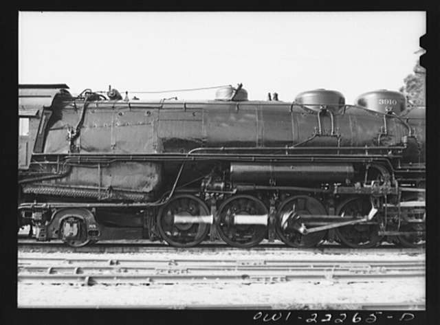 San Bernardino, California. A completely overhauled engine being run on the slip track at the Atchison, Topeka, and Santa Fe Railroad shops. This is done to break the engine in. Note that due to the greased track, the engine is standing still while the wheels are spinning