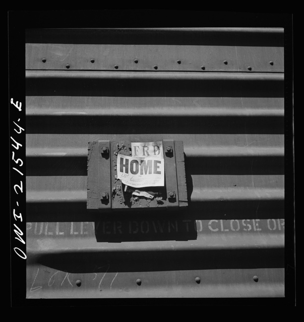 San Bernardino, California. A sign on a freight car indicating that it should be sent back to its own railroad