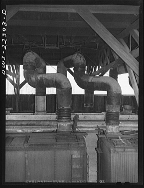 San Bernardino, California. Precooling Atchison, Topeka and Santa Fe Railroad refrigerator cars at the ice plant. Precooling lasts from four to eight hours depending upon the shippers request. Air at twenty degrees Farenheit is blown in one end and out the other. This action is reversed every fifteen minutes. 1000 cubic feet of air goes through the car per minute