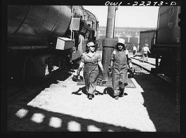 "San Bernardino, California. Women ""suppliers"" who work at the Atchison, Topeka, and Santa Fe Railroad roundhouse. Their job is replacing lamps and oil cans on incoming locomotives. Left to right: Trinidad Gutierrez and Molly Alcanto. Mrs. Gutierrez has four children. Her husband is in the hospital after an injury at the Kaiser Fontana steel mill. Miss Alcanto's boyfriend is in the army"