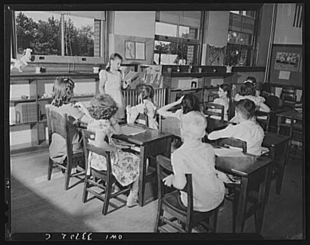 Schenectady, New York. A class at the Elmer Avenue Elementary School. After the children have written stories, they stand up in front of the class, one by one, and read their stories for class discussion