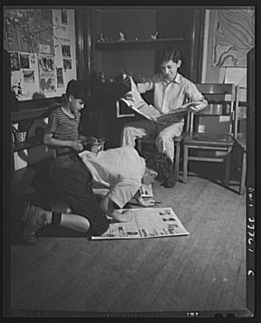 Schenectady, New York. Searching the daily paper for war news to keep the wall map at the Elmer Avenue Elementary School up to date