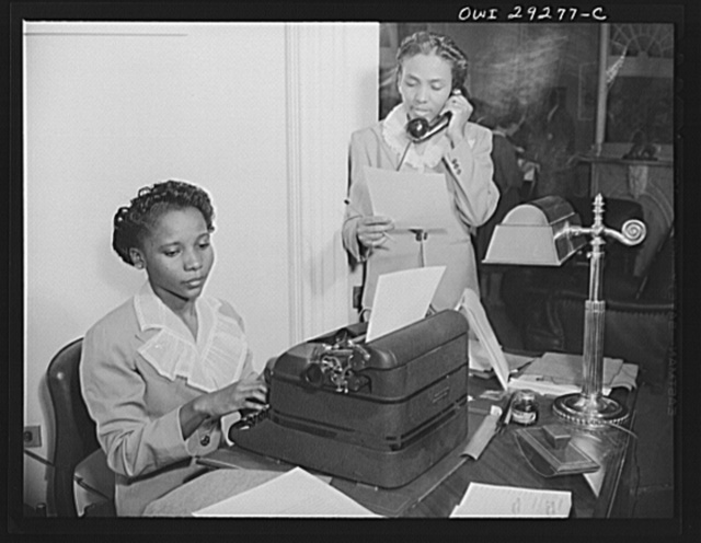 Secretarial staff for Liberian President. Miss Aurelia Toyer and Miss Torreceita E. Pinder, stenographers in the United States State Department, were assigned to the staff of his Excellency, Edwin Barclay, President of the Republic of Liberia, during his stay at the historic Blair House in Washington, D.C. Miss Toyer seated at typewriter is a native of Bluefield, West Virginia and Miss Pinder comes from Gainesville, Florida