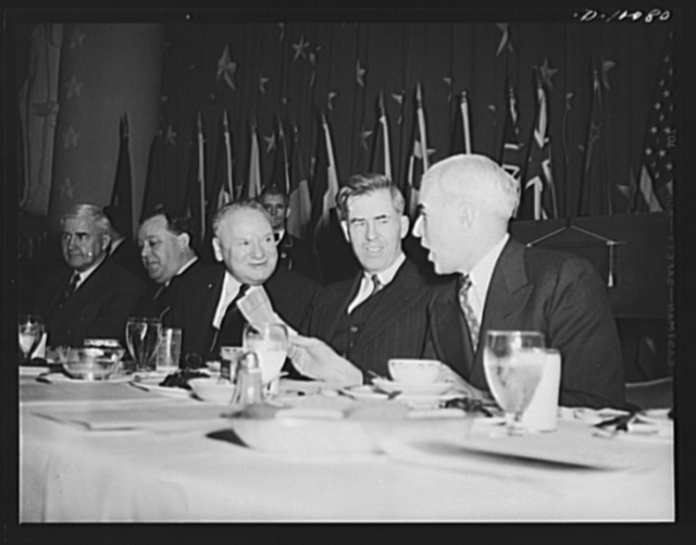 Secretary of Commerce Jesse Jones; Norwegian foreign minister Trygze Lie; Russian ambassador Maxim Litvinov; Vice-President Henry A. Wallace and lend-lease Administrator Edward R. Stettinius, Jr., at luncheon in observance of second anniversary of lend- lease, on March 11, 1943, at the Hotel Statler, Washington, D.C.