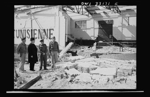 Sfax, Tunisia. Archbishop Francis H. Spellman of New York, viewing bomb damage to the city only recently evacuated by the Germans and Italians
