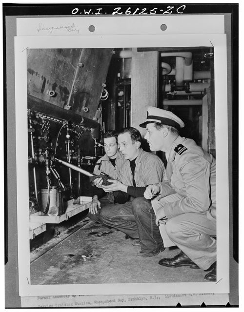 Sheepshead Bay, Brooklyn, New York. Burner assembly by two members of an engineering class at the United States Maritime Service training dtation. Lieutenant L.M. Breece, USNR, is the instructor