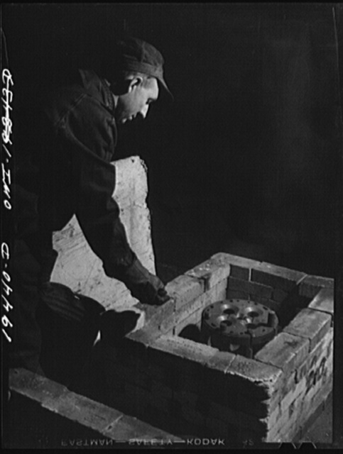 Shopton, near Fort Madison, Iowa. At the Atchison, Topeka and Santa Fe Railway diesel head shop, a diesel cylinder head being heated in a brick oven before welding cracks it