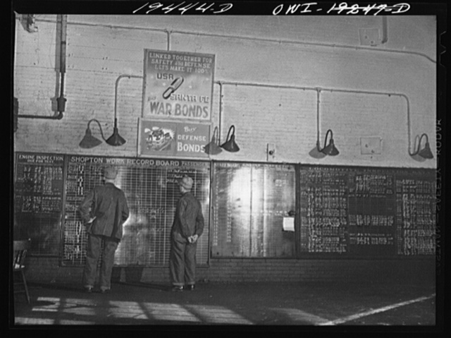 Shopton, near Fort Madison, Iowa. Atchison, Topeka and Santa Fe Railway workmen in the roundhouse studying work schedule