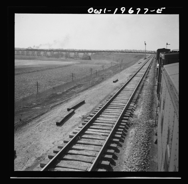 Sibley, Missouri. A freight train on the Atchison, Topeka, and Santa Fe Railroad between Marceline, Missouri and Argentine, Kansas going across the Missouri river