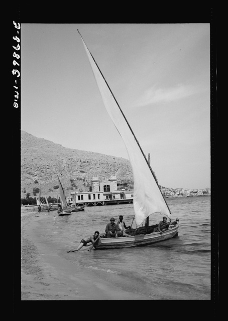 Sicilian boys with their sailboat. The people are returning pretty much to normal since the cessation of hostilities