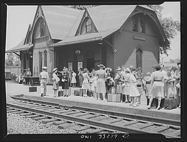 Silver Spring, Maryland. People waiting for a train at the railroad station