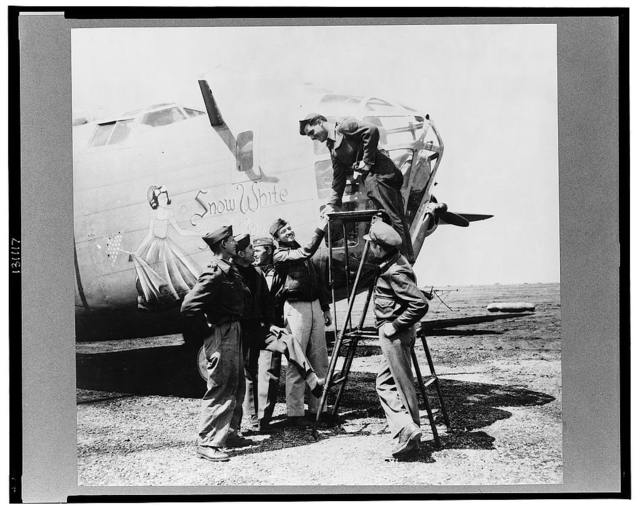 Snow White, a B-24 bomber of the U.S. Army 9th Air Force at a forward bomber base in the Libyan desert. Among its crew, there are four members who flew the ship across the Atlantic and piloted it through thirty-six missions, compiling 300 combat hours in the Middle East