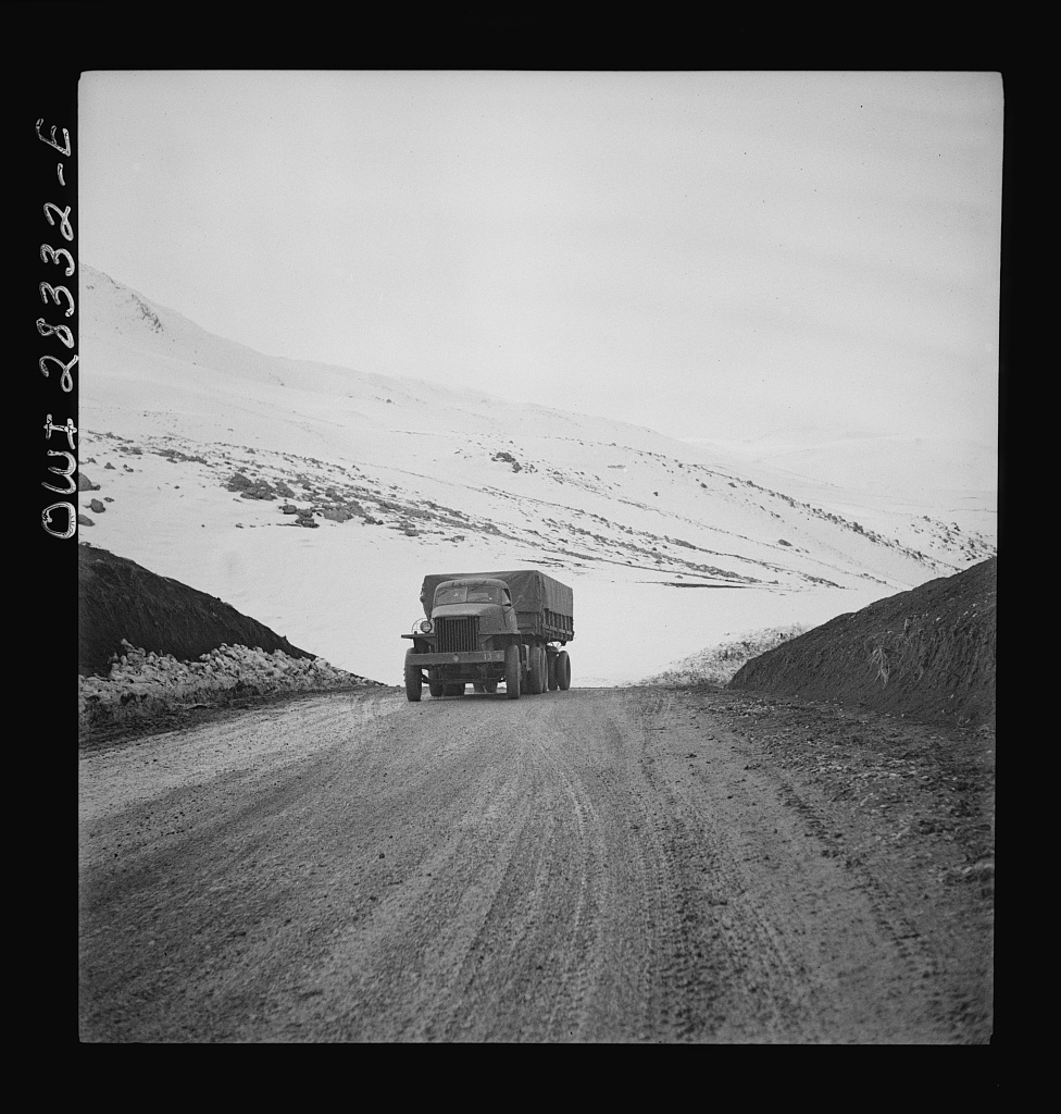 Somewhere in the Persian corridor. A United States Army truck convoy carrying supplies for the aid of Russia climbing a mountain road over the Iranian mountains