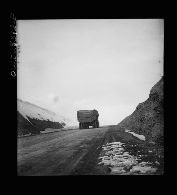 Somewhere on the Persian corridor. A United States Army truck convoy carrying supplies for the aid of Russia on a mountain road