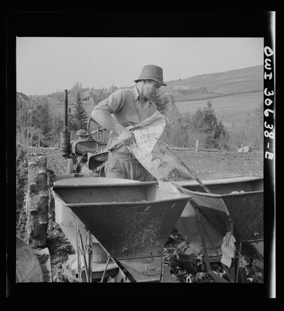 Spring potato planting on the French Acadian farm of Leonard Gagnon. Fort Kent, Aroostook County, Maine