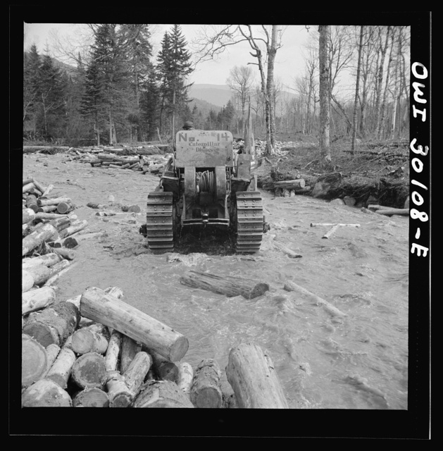 Spring pulpwood drive on the Brown Company timber holdings in Maine. Bulldozer clearing a channel in Dennison Bog Brook so that another jam will not form