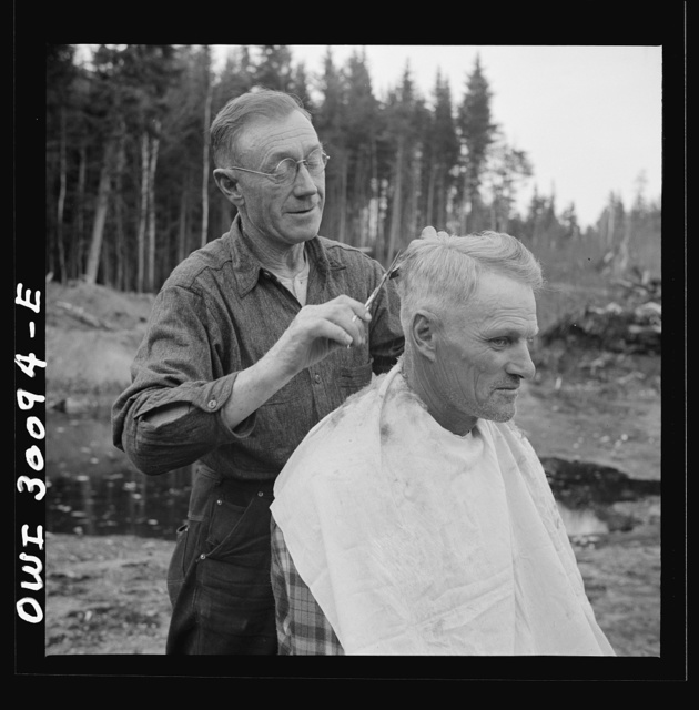 Spring pulpwood drive on the Brown Company timber holdings in Maine. Camp handy man is conveniently handy with the scissors; the nearest professional barber is thirty-five miles away