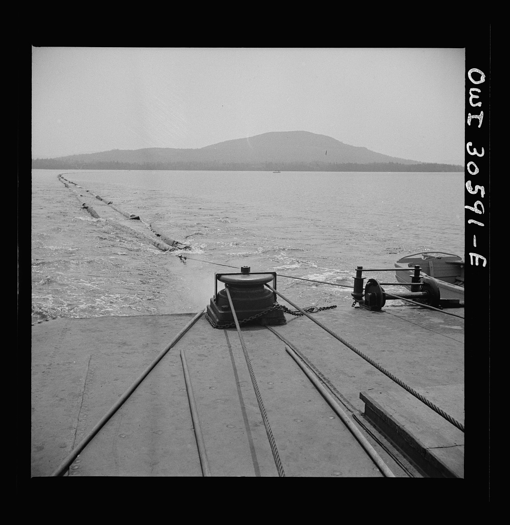Spring pulpwood drive on the Brown Company timber holdings in Maine. On its return trip up Mooselookmeguntic Lake, the steamer tows an empty boom to be refilled for the next day's load