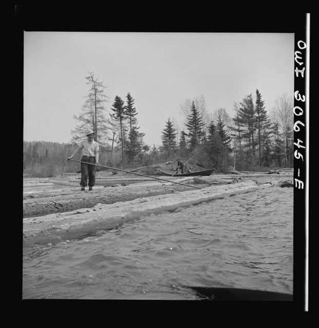 Spring pulpwood drive on the Brown Company timber holdings in Maine. Opening up an empty boom at the upper end of Mooselookmeguntic Lake so it can be filled with more logs from the Kennebago River