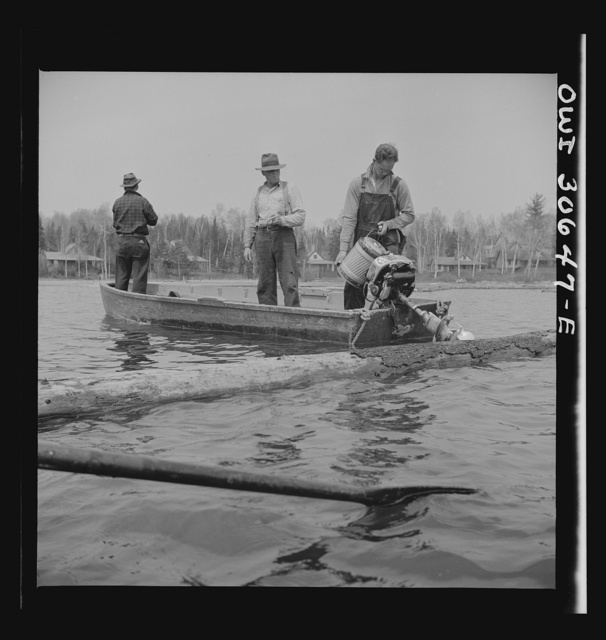 Spring pulpwood drive on the Brown Company timber holdings in Maine. Refueling a motorboat used to open an empty boom at the upper end of Mooselookmeguntic Lake so that it can be filled with more logs from the Kennebago River