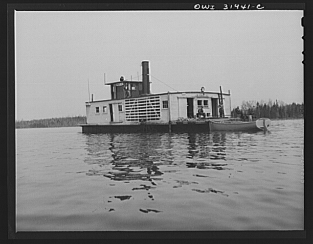 Spring pulpwood drive on the Brown Company timber holdings in Maine. Side-wheel steamer which tows pulp wood twelve miles down Mooselookmeguntic Lake. These lake steamers have two crews, each of which works two six-hour shifts daily