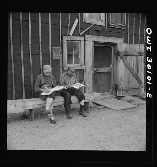 Spring pulpwood drive on the Brown Company timber holdings in Maine. Woodsmen taking it easy in front of the bunkhouse before dinner
