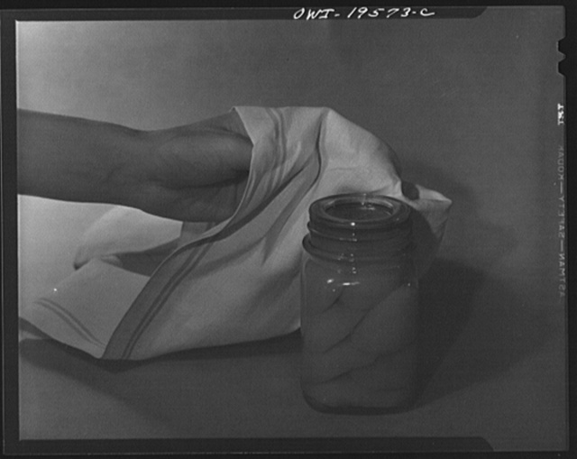 Steel-saving glass-top jars recommended by the War Production Board, Containers Division, for home canning of the Victory garden fruits and vegetables in 1943. Let the jar stand for twelve hours by which time it will have cooled thoroughly. After this the screw bands may be removed permanently since the glass lid and the rubber ring provide a complete seal, with no danger of food spoilage
