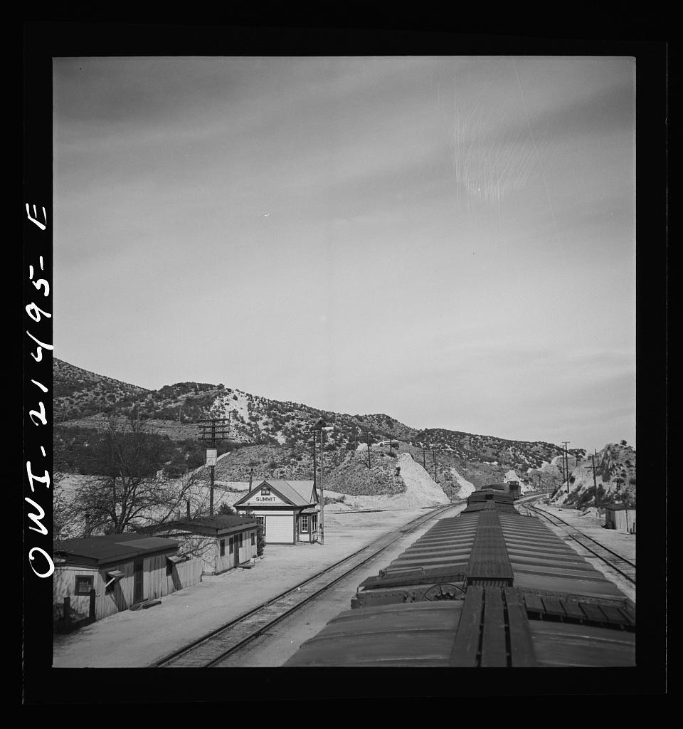 Summit, California. Going through town on the Atchison, Topeka, and Santa Fe Railroad between Barstow and San Bernardino, California