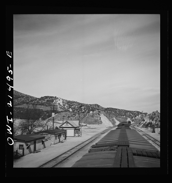 Summit, California. Going through town on the Atchison, Topeka, and Santa Fe Railroad between Barstow and San Bernardino, California